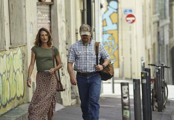 This image released by Focus Features shows Camille Cottin, left, and Matt Damon in a scene from Stillwater. (Jessica Forde/Focus Features via AP)