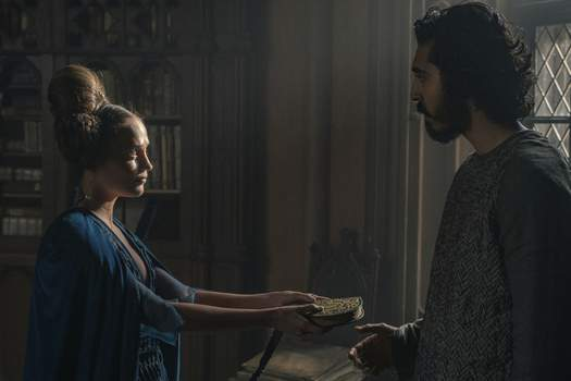 Film Review - The Green Knight This image released by A24 shows Alicia Vikander, left, and Dev Patel in a scene from