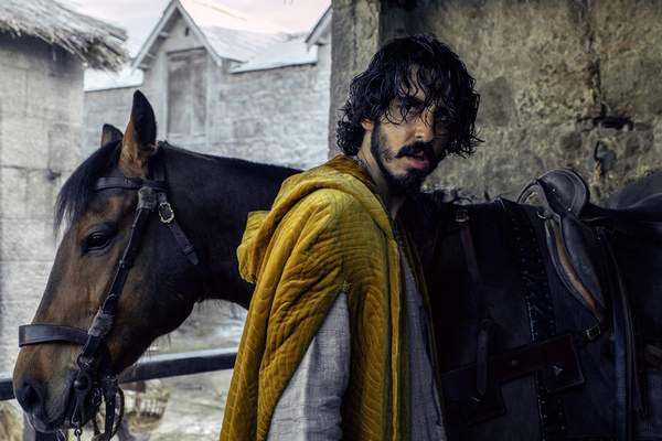 This image released by A24 shows Dev Patel in a scene from The Green Knight. (Eric Zachanowich/A24 Films via AP)
