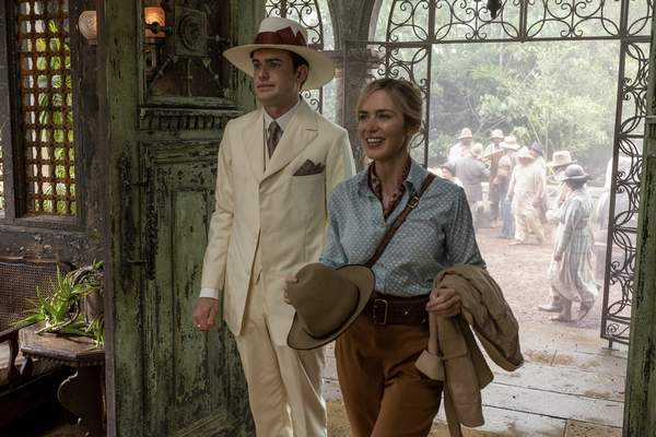 This image released by Disney shows Jack Whitehall, left, and Emily Blunt in a scene from Jungle Cruise. (Disney via AP)