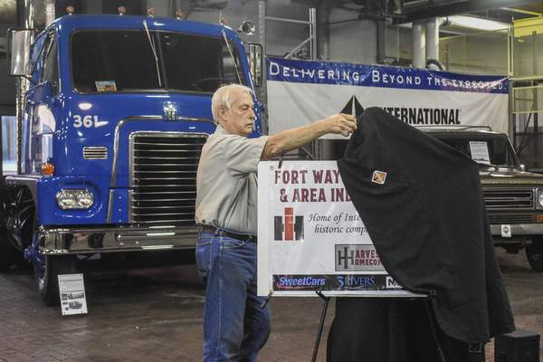 Photos by Michelle Davies | The Journal Gazette Jerry Betley, co-founder and board vice president of  Harvester Homecoming, unveils a sign Friday that reveals plans for a museum at the former International Harvester engineering complex on Meyer Road.