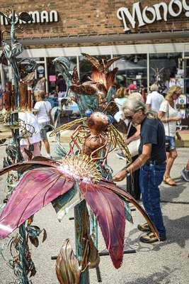 Mike Moore | The Journal Gazette Metal sculptures for sale at the Covington Art Fair on Saturday.