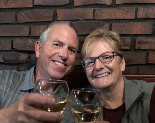 Courtesy  Dave and Janet Renauld, who retired last year months into the coronavirus pandemic, enjoy a toast.