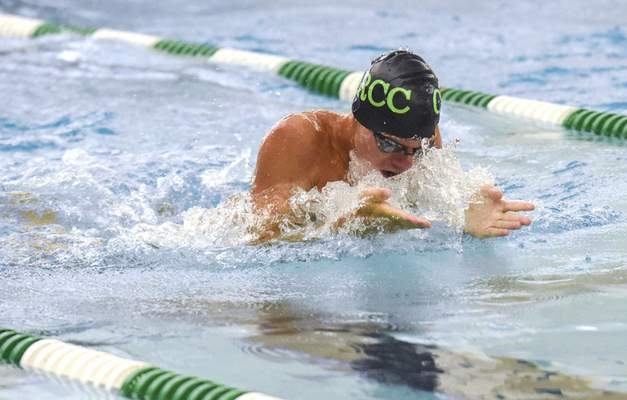 Michelle Davies   The Journal Gazette  Orchard Ridge's Tommy McComb competes in the Boys 15 & Over 50 SC Meter Breast Stroke Sunday morning at 2021 Fort Wayne City Swim Meet at the Helen P. Brown Natatorium. He took fifth place in the event.