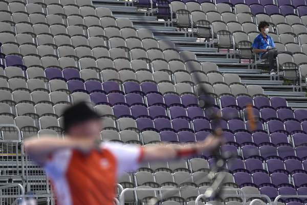 A man sits on the stands during the men's team competition at the 2020 Summer Olympics, Monday, July 26, 2021, in Tokyo, Japan. (AP Photo/Alessandra Tarantino)