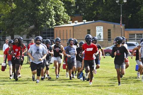 Photos by Katie Fyfe   The Journal Gazette The Bishop Luers football team warms up before the first official day of practice Monday.