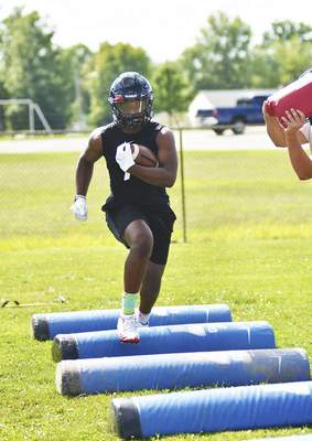 Bishop Luers junior Davon Doeghty runs through a drill during Monday's practice session. The Knights were state runners-up in Class 2A last year.