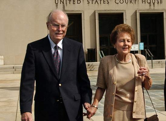 FILE - In this Sept. 2, 2003 file photo, from left, Jack and Jo Ann Hinckley, parents of John Hinckley, leave the U.S. Courthouse in Washington after a hearing regarding John Hinckley's visitation privileges. (AP Photo/Gerald Herbert, File)
