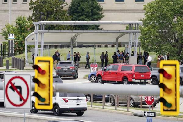 Police vehicles are seen outside the Pentagon Metro area Tuesday, Aug. 3, 2021, at the Pentagon in Washington. (AP Photo/Andrew Harnik)