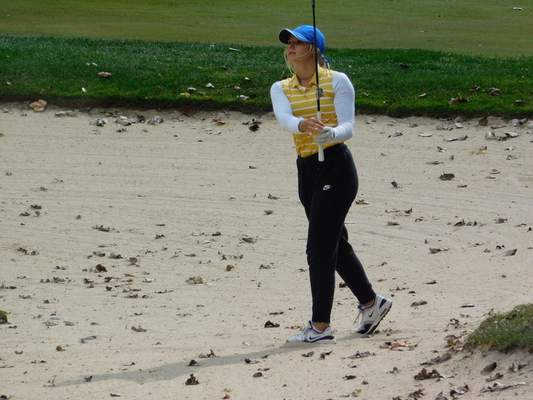 File Homestead junior Madison Dabagia watches her shot as she hits out of the sand trap on the second day of the 2020 Girls State Golf Finals at Prairie View Golf Club in Carmel.