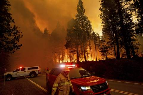 California Wildfires Associated Press Flames leap from trees Tuesday as the Dixie Fire jumps Highway 89 north of Greenville in Plumas County in Northern California. (Noah BergerFRE)
