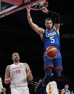 Associated Press Zach Lavine scores over Spain's Marc Gasol during the men's quarterfinal game won by the United States at the Olympics on Tuesday in Saitama, Japan.