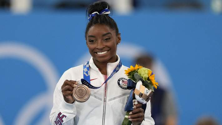 Biles earned the bronze medal for the artistic gymnastics women's balance beam Tuesday in Tokyo.