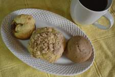 Photos by Corey McMaken | The Journal Gazette From left: A Jam Muffin, a Sour Cream Coffee Cake Muffin with Streusel and a Hot Chocolate Muffin