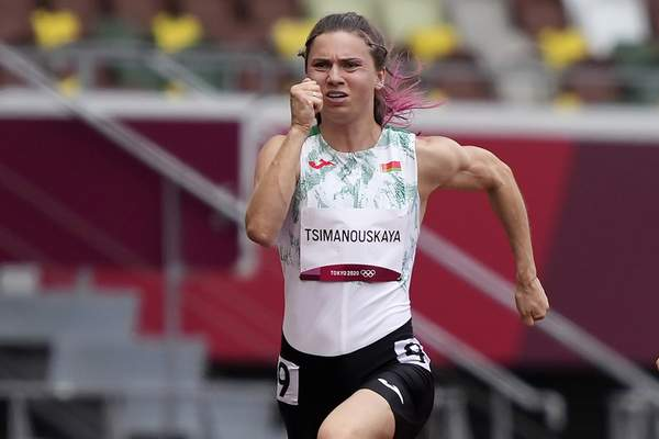 FILE In this file photo taken on Friday, July 30, 2021, Krystsina Tsimanouskaya, of Belarus, runs in the women's 100-meter run at the 2020 Summer Olympics, Japan. A feud between Belarusian Olympic sprinter Krystsina Tsimanouskaya and team officials that prompted her to seek refuge in Poland has again cast a spotlight on the repressive environment in the ex-Soviet nation, where authorities have unleashed a relentless crackdown on dissent. (AP Photo/Martin Meissner, File)