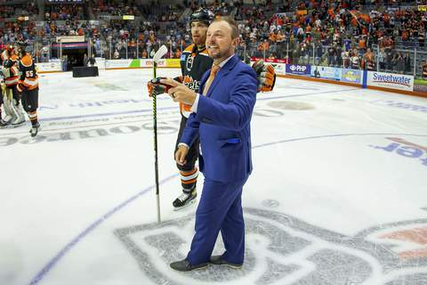 Josh Gales| Special to The Journal Gazette  Komets coach Ben Boudreau, right, walks off the Memorial Coliseum ice with Anthony Nellis after winning the Western Conference championship in June. (Josh Gales)