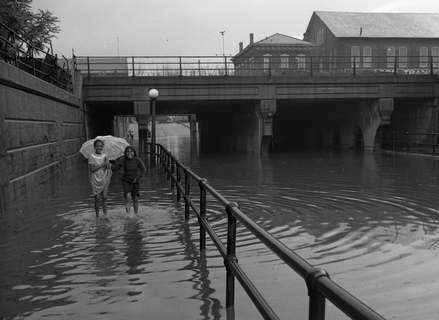 July 16, 1947: Two young people splash near a flooded underpass. (Journal Gazette file photo)