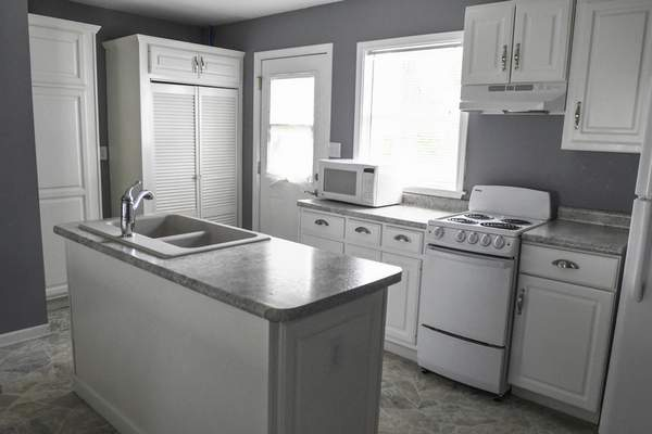 Michelle Davies   The Journal Gazette The kitchen of a home on Fairfax Avenue, one of the houses renovated as part of the Bridge of Grace revitalization project.