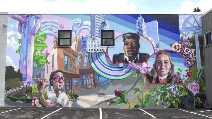 Bradley is chair of the Faces of the Fort committee, which helped produce murals, such as this one at 1514 St. Joseph Blvd. that features City Councilman Glynn Hines and Genevieve Meyer. The mural, painted by Benjamin Duke, is part of the Faces of the Fort project.