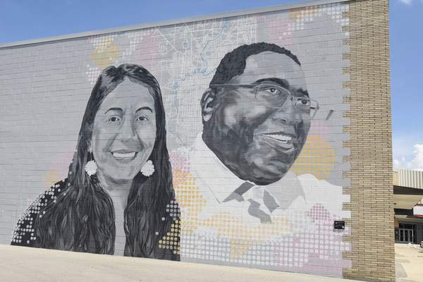 Michelle Davies   The Journal Gazette  RénaBradley is chair of the Faces of the Fort committee, which helped produce murals, such as this one1818 Bluffton Road that features Raquel Kline and Thomas Smith, painted by Mitchell Egly. The mural is part of Faces of the Fort, featuring hometown heroes and focuses on celebrating the culture of Ft Wayne's diverse population and highlighting people who have made contributions to the advancement of civil rights social justice and immigrant quality of life in the community.