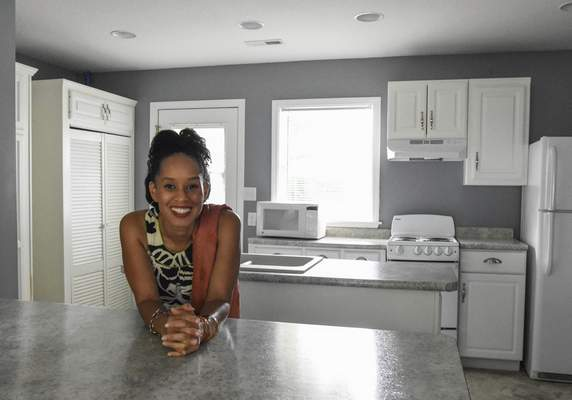 Photos by Michelle Davies   The Journal Gazette Réna Bradley stands in the kitchen of a home on Fairfax Avenue, one of the houses she helped renovate as part of the Bridge of Grace revitalization project in the Mount Vernon Park neighborhood.