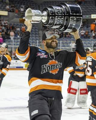 Josh Gales | Special to The Journal Gazette  Marcus McIvor celebrates after winning the Kelly Cup with the Komets in July.