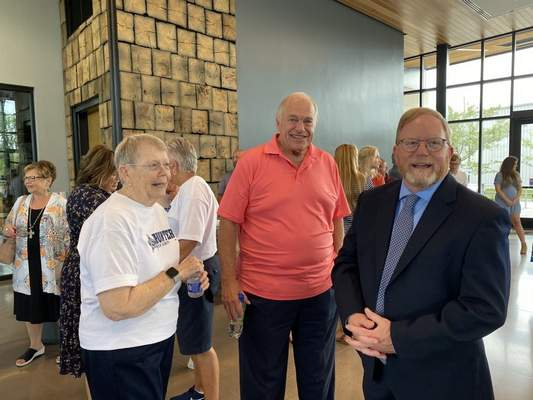 Jamie Duffy/The Journal Gazette  Capt. Kevin Hunter (right) announced his candidacy for Allen County Sheriff Wednesday at Promenade Park Pavilion. He is with his campaign manager, Stan Davis, and mother, Penny Henshaw.