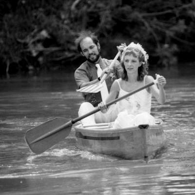 July 14, 1984: Canoe enthusiasts Sharon Truelove, 26, and Dennis Bidwell, 29, row to shore after being married in a floating wedding on the St. Marys River near the Old Fort. Back on land, they had a potluck lunch with friends. (Journal Gazette file photo)
