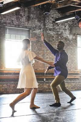 Ashley Benninghoff and A.J. Crowder rehearse a partnered dance for this weekend's performances.