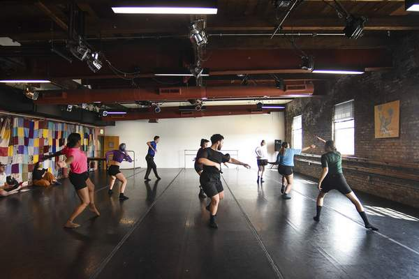 Katie Fyfe   The Journal Gazette  Dancers rehearse on Sunday for the Fort Wayne Dance Collective's Touring Company's upcoming CollectiveExpressions show.
