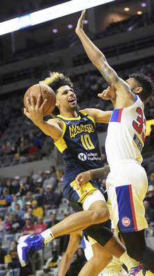 Katie Fyfe   The Journal Gazette  Brian Bowen II, left, takes a shot for the Mad Ants against Grand Rapids' Todd Withers at Memorial Coliseum on March 8, 2020.