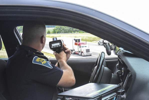Michelle Davies   The Journal Gazette  Sgt. Brian Walker, public information officer for the Indiana State Police Fort Wayne Post, monitors speeds on Interstate 469 from Winchester Road on Friday afternoon. Walker says more drivers are exceeding 100 mph than the past.