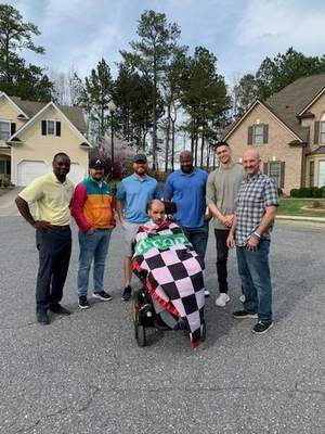 Courtesy  Former Leo High School player and coach Phil Bollier, top right, and some players from his original 2005 Mill Creek High School team in Hoschton, Ga., with the person Bollier calls the team founder, Michael Johnson during a 2020 reunion.