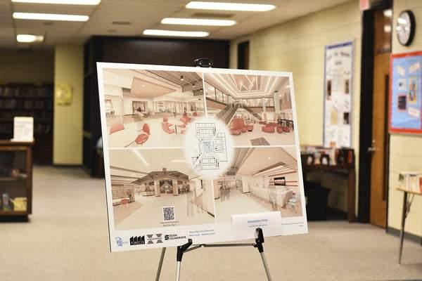 Katie Fyfe | The Journal Gazette  Photos of what Wayne High School will look like after the renovations that begin in January are placed throughout the school during Wayne High School's 50th anniversary celebration on Saturday.