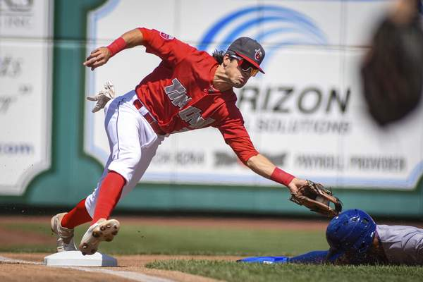 Mike Moore | The Journal Gazette  TinCaps third baseman Ethan Skender reaches for the tag in the first inning against South Bend on Sunday.