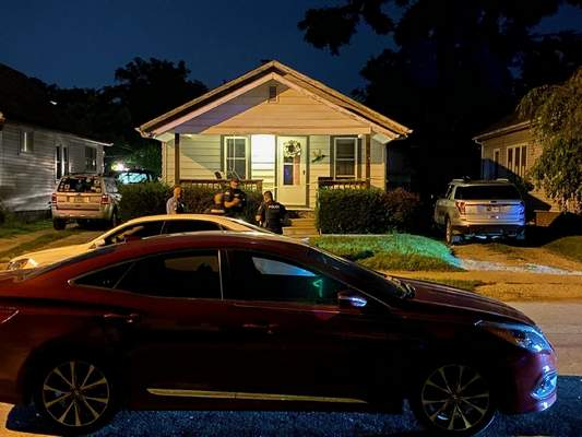 Photos by Jamie Duffy | The Journal GazetteFort Wayne police gather outside a home in the 4000 block of Hoagland Avenue near West Rudisill Boulevard where two people were shot.