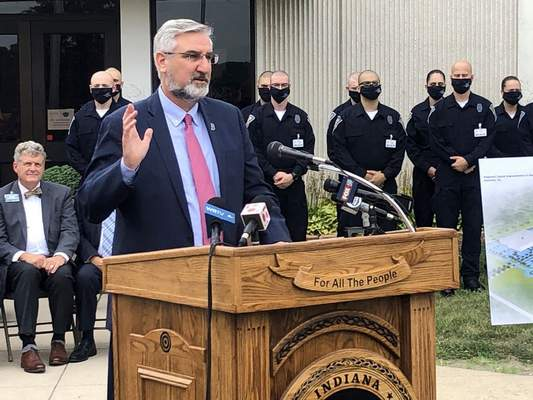 Indiana Gov. Eric Holcomb speaks during a bill signing ceremony at the Indiana Law Enforcement Academy in Plainfield, Ind., Monday, Aug. 16, 2021. (AP Photo/Tom Davies)