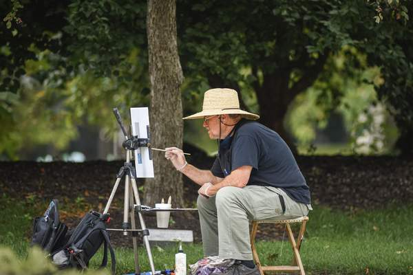 Photos by Mike Moore   The Journal GazetteAvon Waters paints at Friemann Square last week during one of the Fort Wayne Artists Guild's Month of Plein Air events. More activities are planned through August.