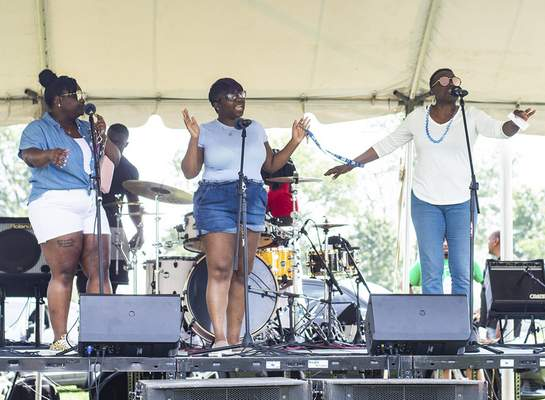Photos by Katie Fyfe | The Journal Gazette From left, Mariah Wells, Brittani Rodriguez and Rozeta Beasley, with Redemption Church perform during the 10th annual Summit City Community Festival at McMillen Park on Saturday.