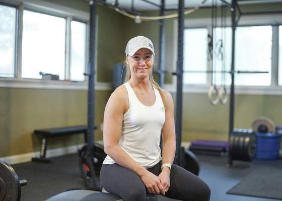 Mike Moore | The Journal Gazette Fitness trainer Dani Rice poses for a photo at her gym in her home on Sutters Parkway on Saturday.