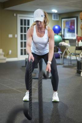 Mike Moore | The Journal Gazette Fitness trainer Dani Rice works out at her gym in her home on Sutters Parkway on Saturday.