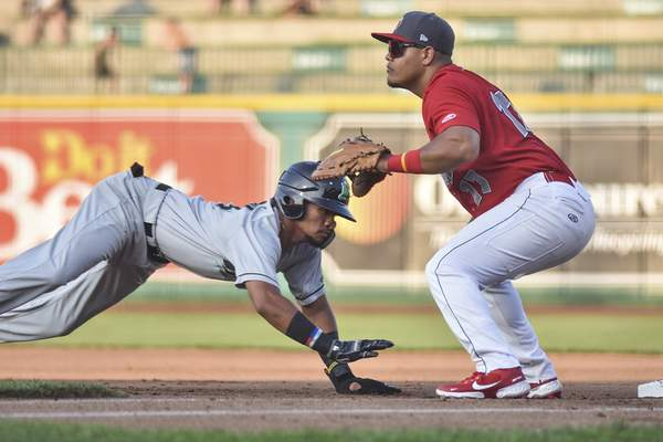 Katie Fyfe   The Journal Gazette  The TinCaps' Yorman Rodriguez prepares to catch the ball as Dayton's Allan Cerda slides back into first base during the second inning at Parkview Field on Wednesday.