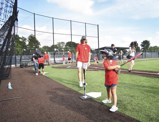 Katie Fyfe | The Journal Gazette Boys & Girls Club kids and local police interact during the baseball clinic Badges for Baseball at the Academy of Sports & Health Centre on Wednesday.
