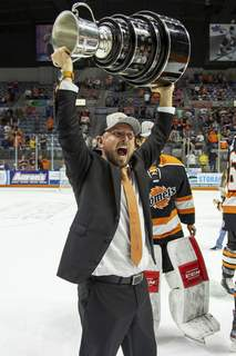 Josh Gales | Special to The Journal Gazette  Coach Ben Boudreau celebrates with the Kelly Cup after the Komets captured the ECHL championship at Memorial Coliseum in July.