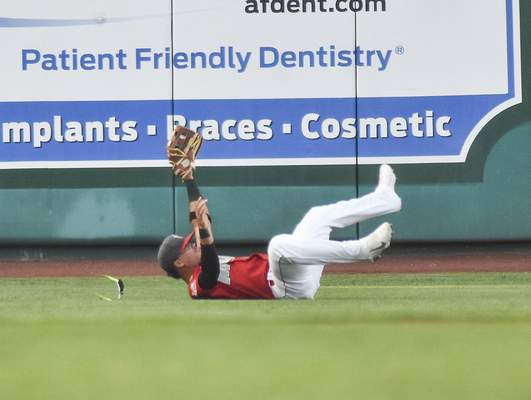Katie Fyfe | The Journal Gazette  The TinCaps' Luis Almanzar dives and catches the ball during the third inning against Dayton at Parkview Field on Wednesday.