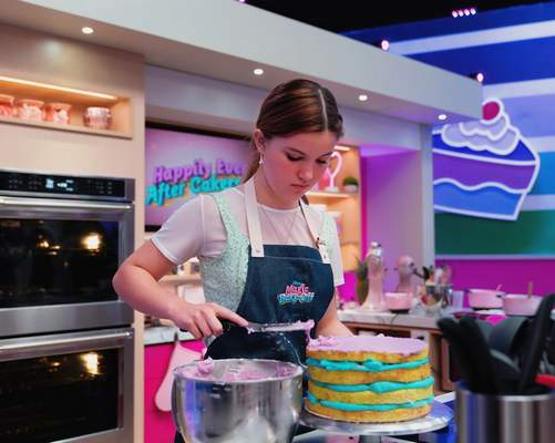 """Courtesy Kenady Hall ices a cake in an episode of """"Disney Magic Bake-Off"""" that airs tonight."""