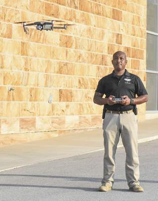 """Michelle Davies   The Journal Gazette FWPD officer Bobby Lemon, lwith The Fort Wayne Police Department Aerial Support Unit (ASU) demonstrates how to operate a drone Saturday morning at Sweetwater Sound during the first """"Hobbyist Drone Conference"""". The conference was designed for drone hobbyists and focused on drone safety, rules, and regulations. Lemon is operating a Mavick 2 Pro."""