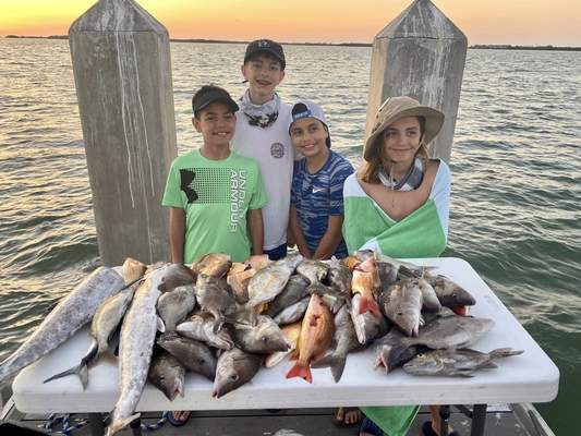 Fort Wayne residents, from left, Trason Fish, 11, Cole Zent, 13, Tristen Fish, 10, and Carter Zent, 11, caught king mackerel, mangrove snapper and lane snapper in the Gulf Of Mexico, off Fort De Soto Park, Fla., during spring break this year.