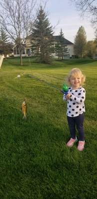 Olivia Blythe, 2, caught her first fish at a pond behind her house in Fort Wayne with help from her father, Ryan Blythe, on her first cast to boot.