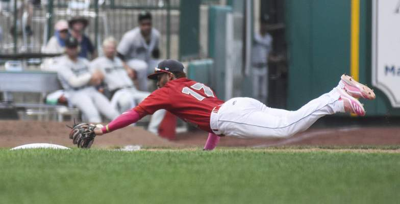 Michelle Davies | The Journal Gazette TinCaps' Euribiel Angeles dives for a ball in the fourth inning of Sunday's game against Dayton at Parkview Field.